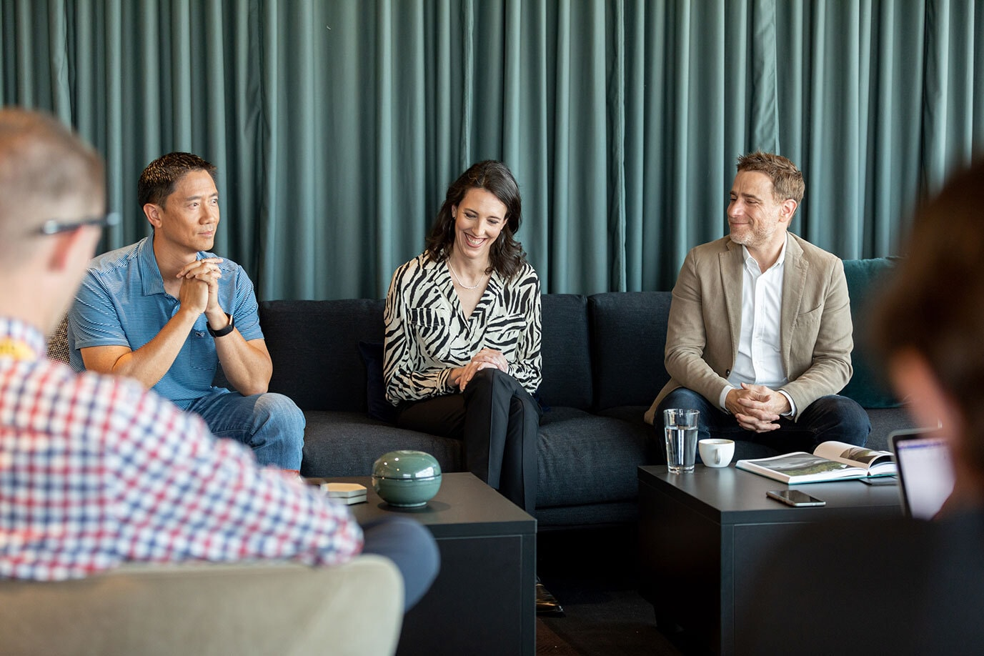 Slack executives (Robby Kwok, VP of People; Ali Rayl, VP customer experience; Stewart Butterfiled, CEO) at the opening of Slack's new office in Denver.