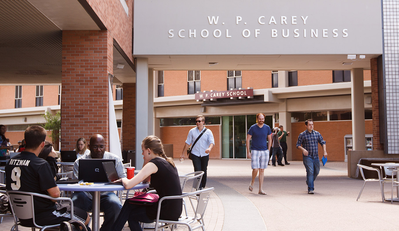A photo of students walking through campus at W.P. Carey School of Business