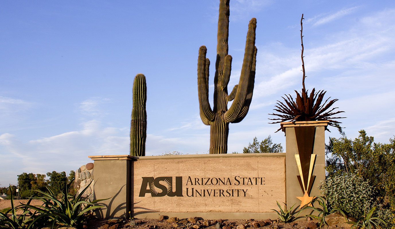 The Arizona State University sign in front of several cactuses.