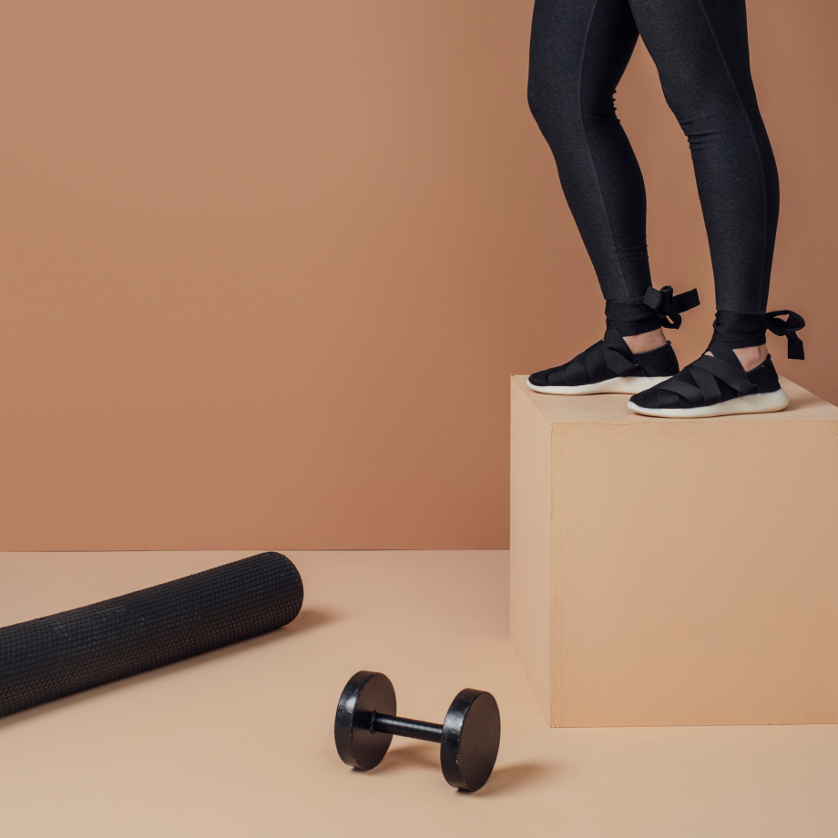 Legs of someone working out, weight and mat