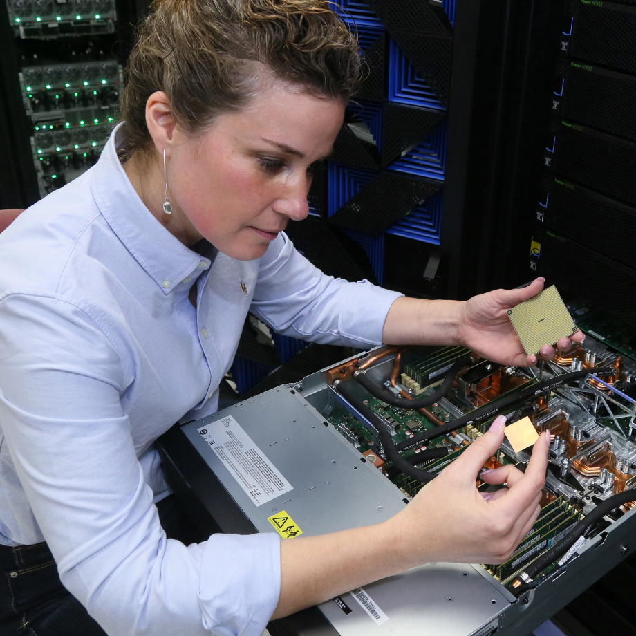 Member of the IBM engineering team looking at a piece of hardware