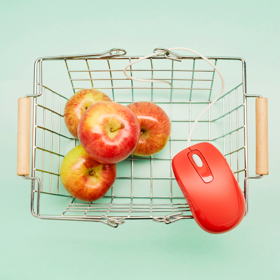 Grocery basket with apples and a computer mouse