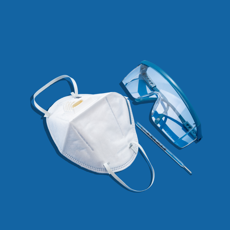 A mask and surgical glasses side by side