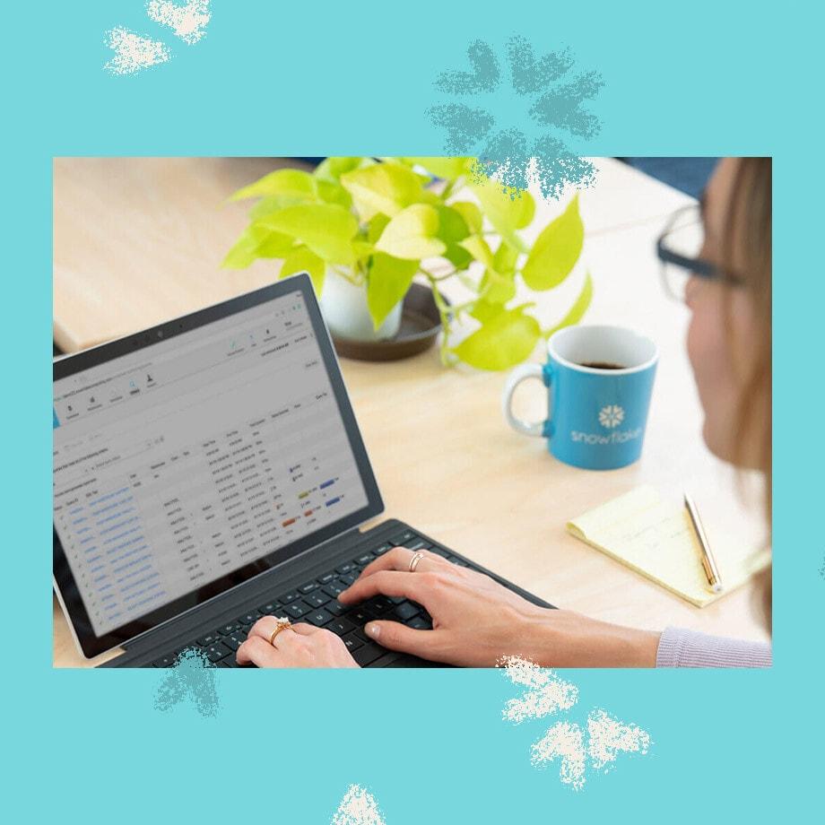 Snowflake employee working on laptop