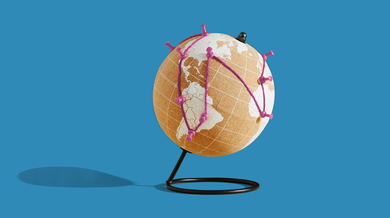 Globe with strings connecting different parts of the world representing the new world of work