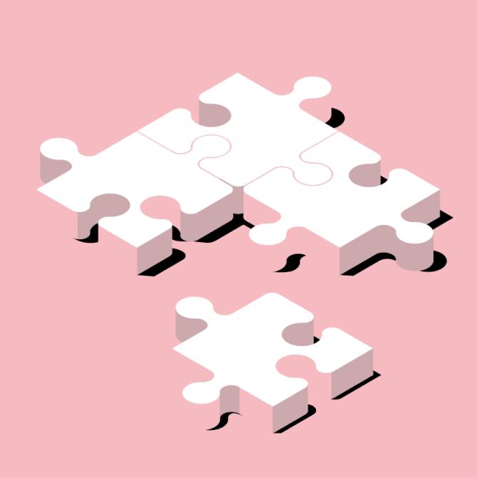 3 つが連結し、1 つが横に離れて置いてある状態の 4 つのパズルのピース。