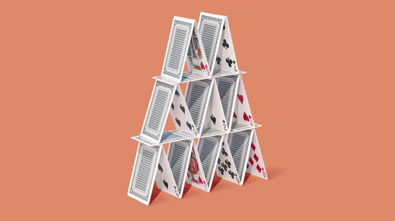 Card pyramid representing collaboration