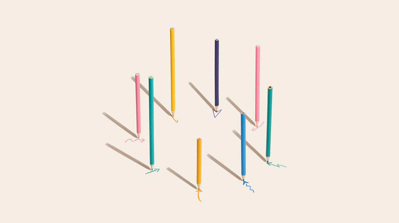 Different colour pencils drawing arrows