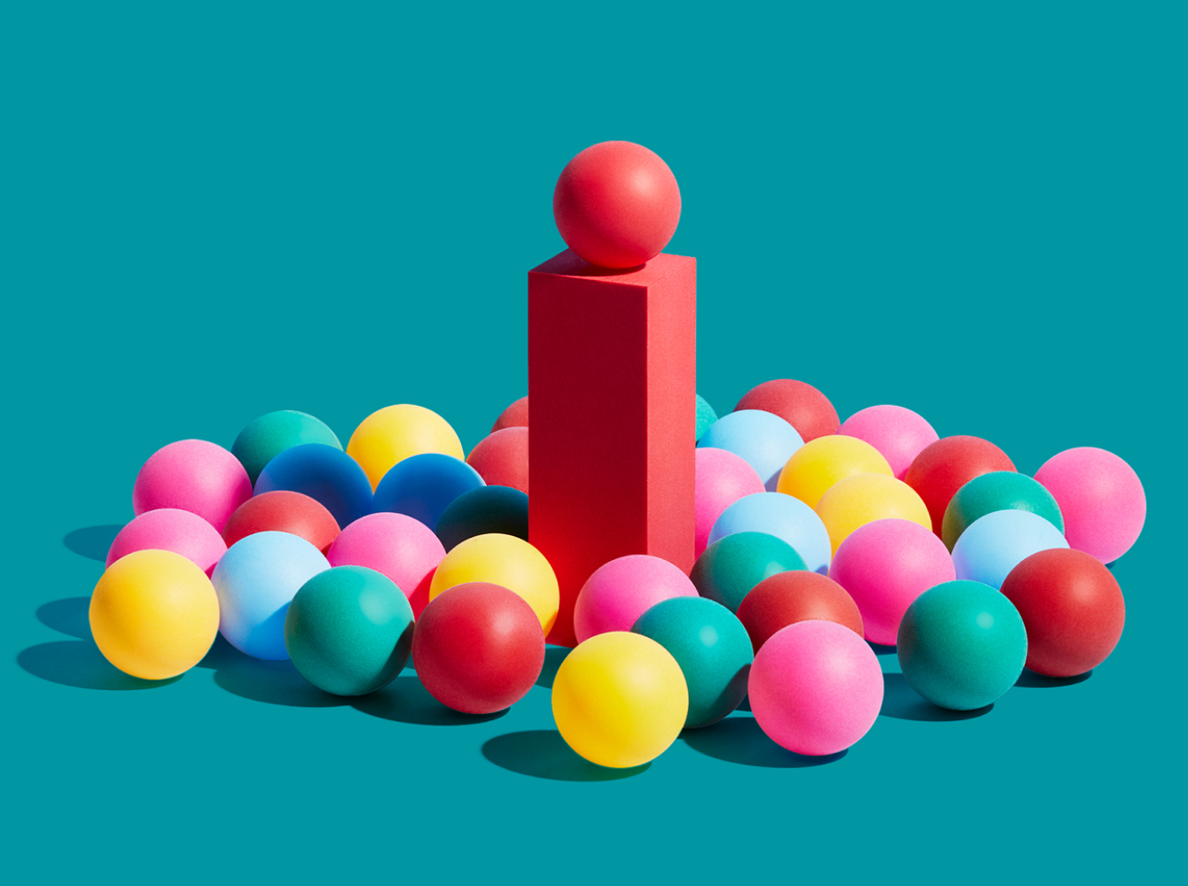 Colorful balls gathered together with one on podium