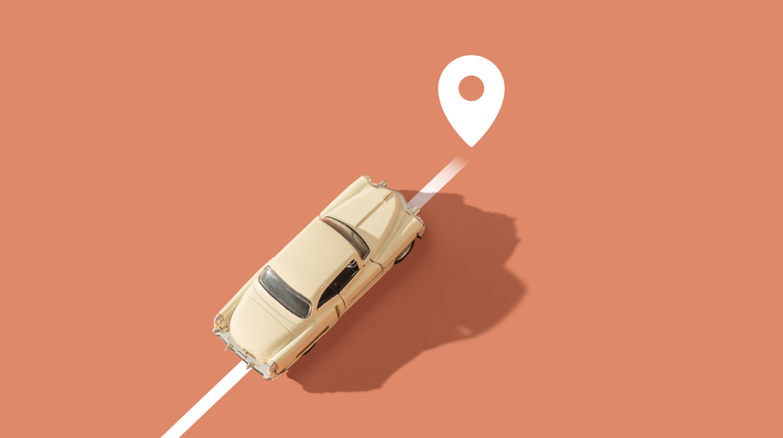 Car driving diagonally towards location mark