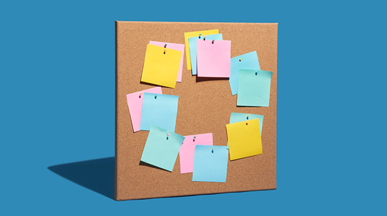 Sticky notes on a bulletin board showing collaboration