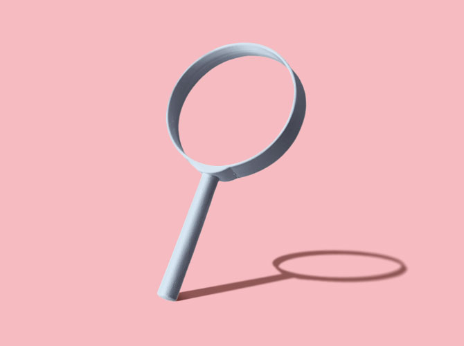 Magnifying glasses on a pink background
