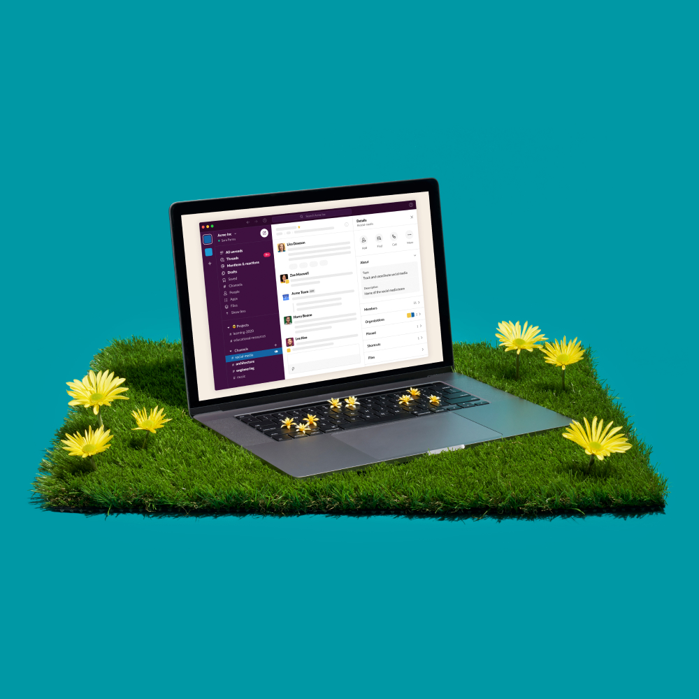 A laptop sits among flowers in the grass, representing a person's ability to work successfully rom anywhere