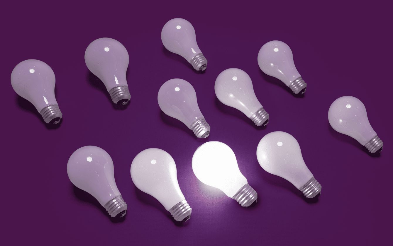 Light bulbs with one lit for getting started in Slack
