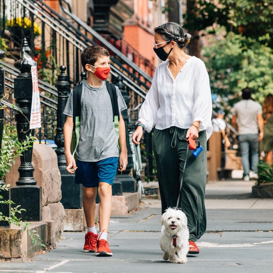 parent and child walking dog