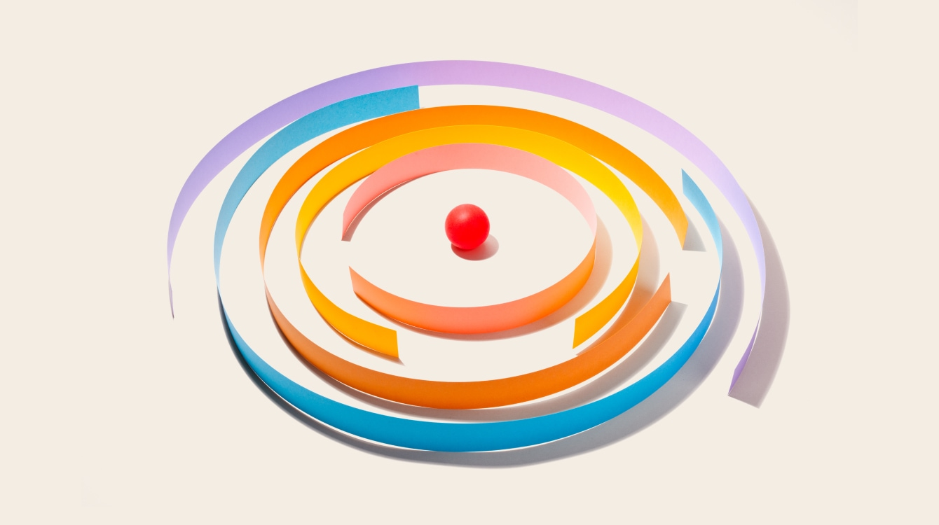 Red ball in the middle of a circle maze representing productivity