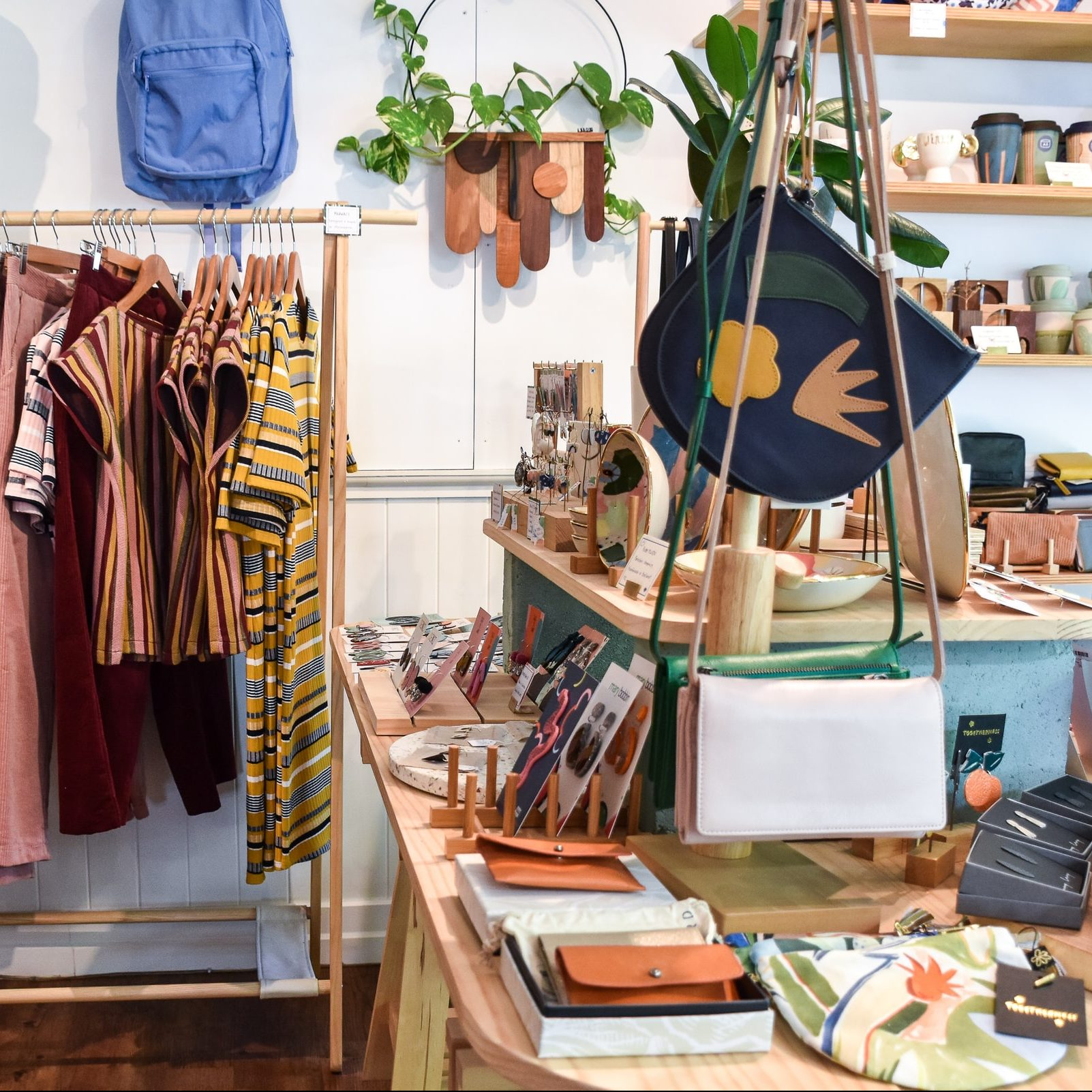 An eclectic mix of ethical clothing and home accessories inside a small shop.