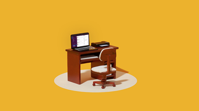 Laptop on desk with chair