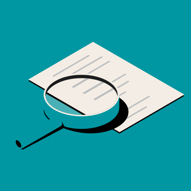 Magnifying glass resting on top of a document