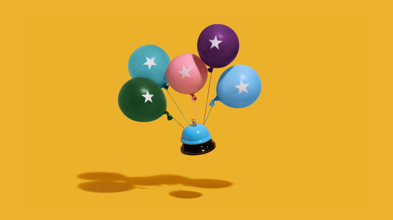 Balloons attached to a bell representing launching Slack