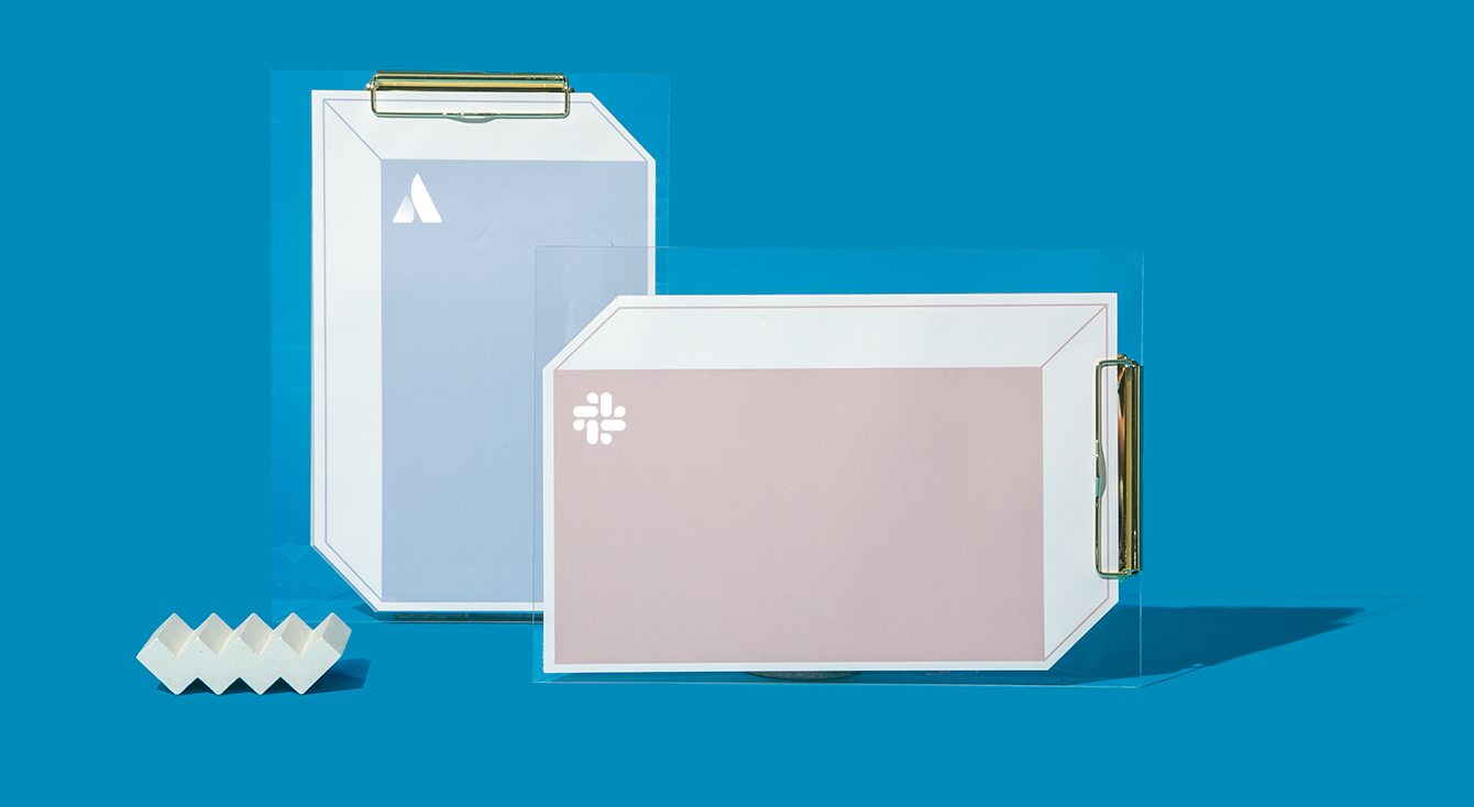Slack & Atlassian logos on boxes with clipboards