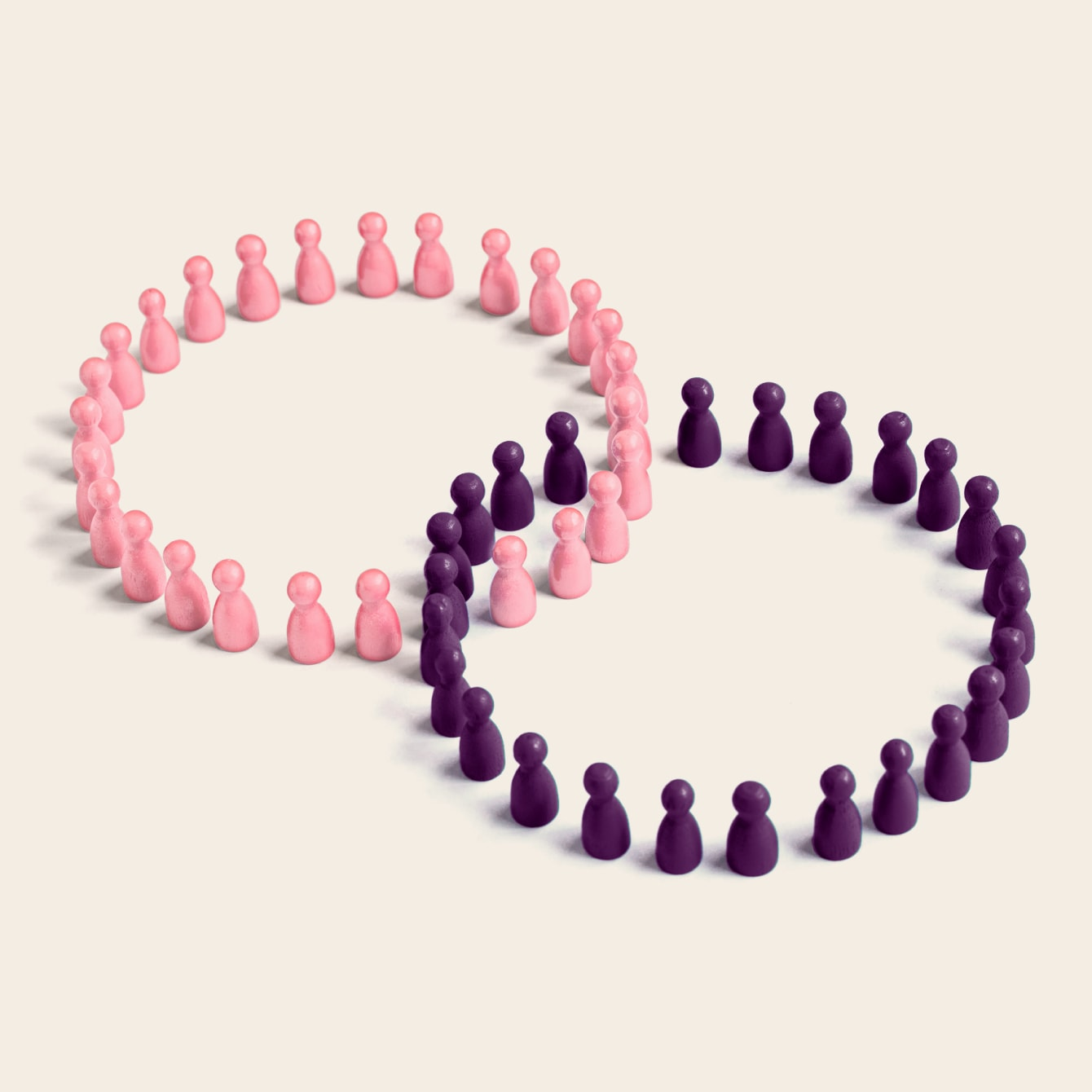 Two conjoined circles of people figurines symbolize connection two organizations via Slack Connect