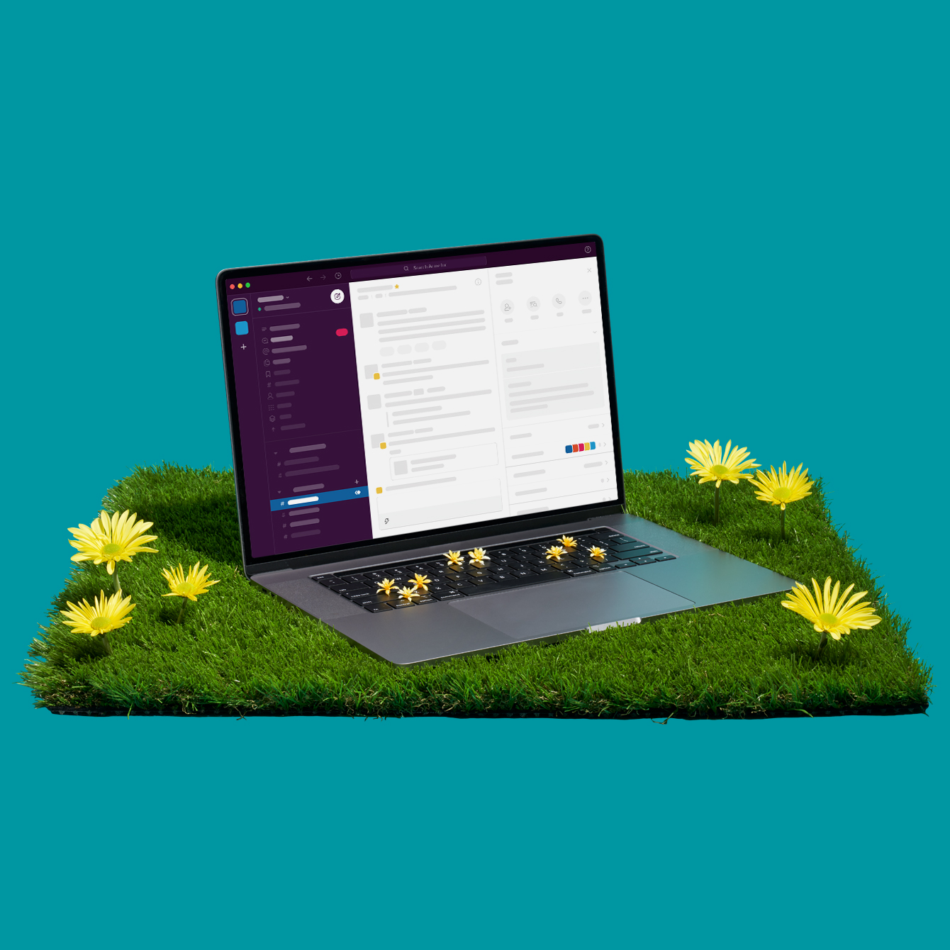 A laptop and blooming flowers sitting on turf