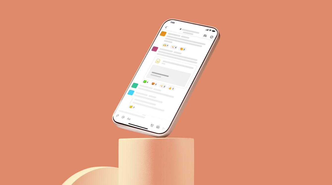 A phone with the Slack app on it balancing on a shape