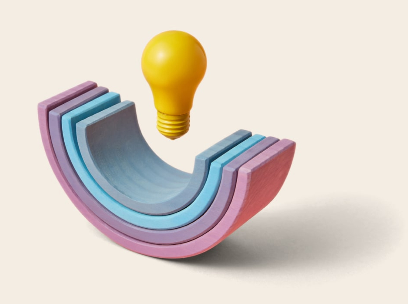 Rainbow shapes with lightbulb representing Why Slack